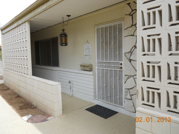 View Of Shaded Entry With Security Door